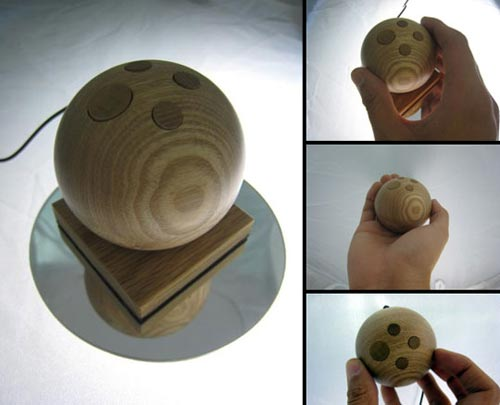 Check out this cool gadget, the Jupiter Wooden Accelerometer mouse.