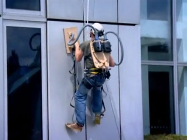 Human Spiderman Scales Walls Using Vacuum Cleaner