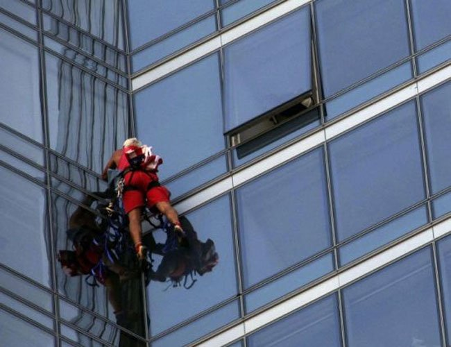 Man Scales 58 Storey Building With Suction Cups