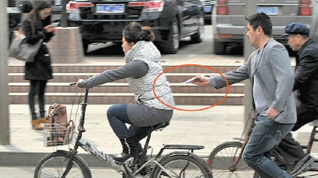 Chinese man pickpockets woman on a bike, steals iPhone…with chopsticks