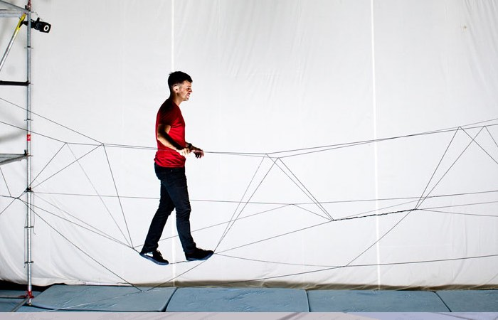 Drones Programmed To Build Rope Bridge