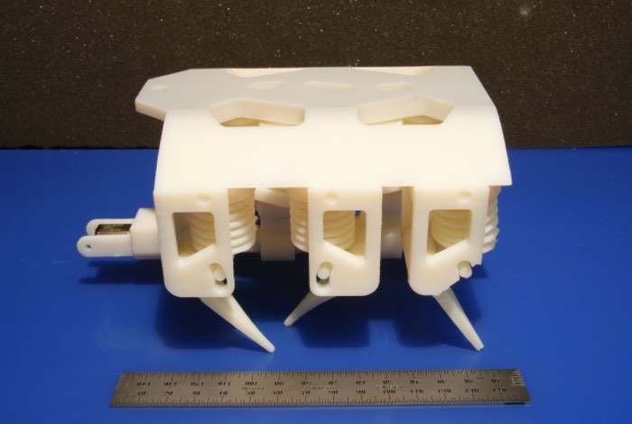 MIT have this week unveiled a new 3D Printed Hydraulic Robot which includes both solids and liquids and can be manufactured without the need for any assembly and takes the form of a small hexapod robot that weighs roughly 1.5 pounds and measures less than 6 inches long.  The new 3D Printed Hydraulic Robot has been created by the Computer Science and Artificial Intelligence Lab at MIT and shows a glimpse at what might be possible in the future and reveals a early way for robots to start building other robots even if they are not as yet capable of carrying out complex tasks.  Check out the video below to learn more about this first-ever 3D printed hydraulic robot that involves printing solid and liquid materials at the same time and was created using a commercially available 3D printer. CSAIL Director Daniela Rus, who oversaw the project and co-wrote the paper explains :  Our approach, which we call 'printable hydraulics,' is a step towards the rapid fabrication of functional machines. All you have to do is stick in a battery and motor, and you have a robot that can practically walk right out of the printer.  For more information on the new 3D Printed Hydraulic Robot jump over to the MIT resources websites for details via the links below.