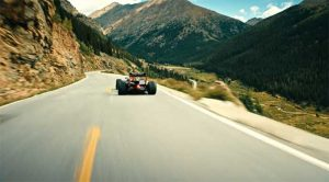 Max Verstappen Racers F1 Car Along the Beach and the Rockies