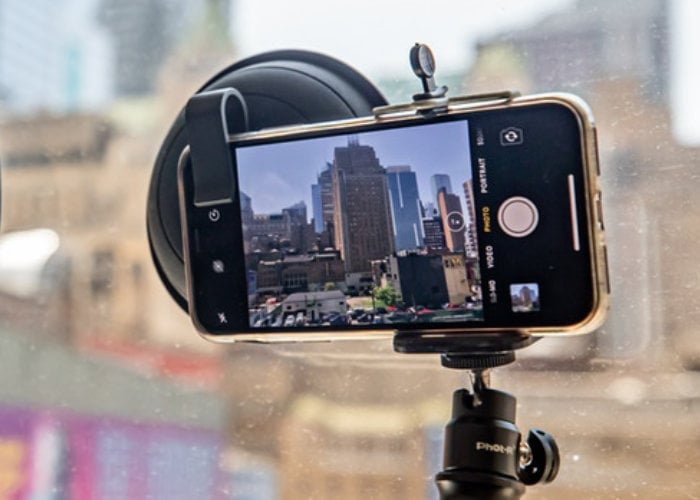 Ultimate Lens Hood 2.0 for smartphones and DSLR removes window reflections