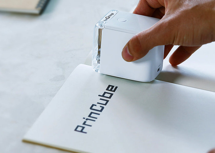PrinCube handheld color printer prints on any surface