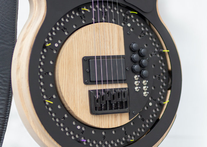 Unique Circle Guitar equipped with a spinning disc for picks - Geeky Gadgets